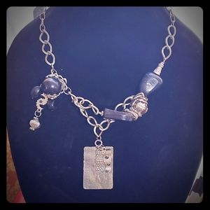 Silver and black multi charm necklace.
